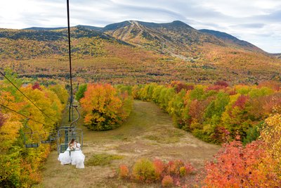 Bride on Chairlift With Fall Foliage, Waterville Valley