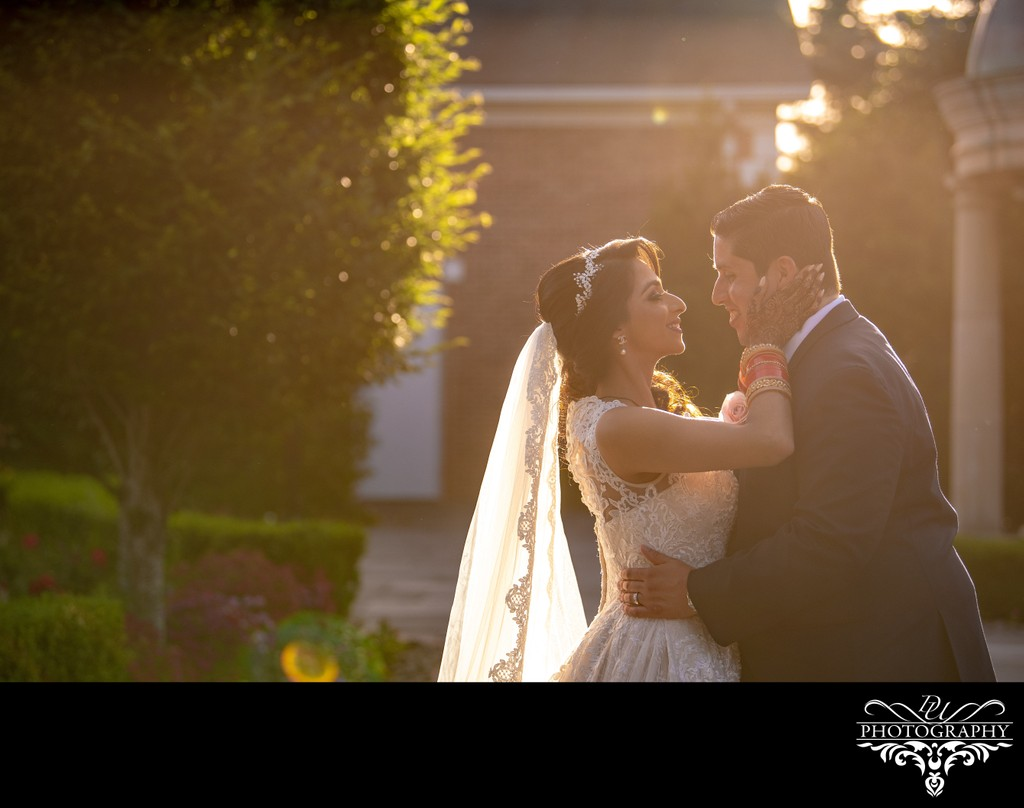 Warm sunset photo of an Indian Catholic fusion wedding at The Rockleigh
