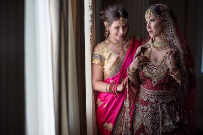 Hindu bride looking out the window at The Merion