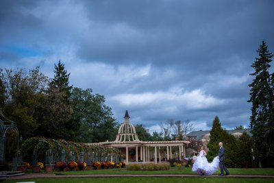 Cloudy photo of the groom helping the bride with her dress