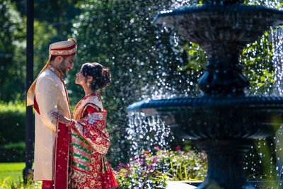 Indian couple smiling at The Rockleigh's Water fountain