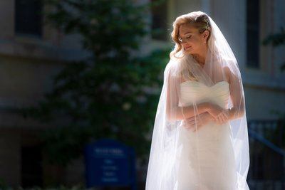 Bride in beautiful sunlight at Seton Hall Church