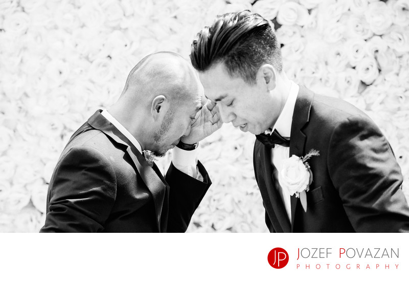 Crying groom and best man at wedding ceremony in Bali
