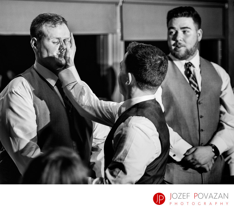 Furry Creek wedding photography groom slapping best man