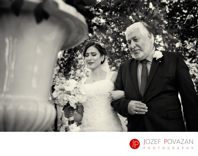 Persian bride and dad walking down the isle to ceremony
