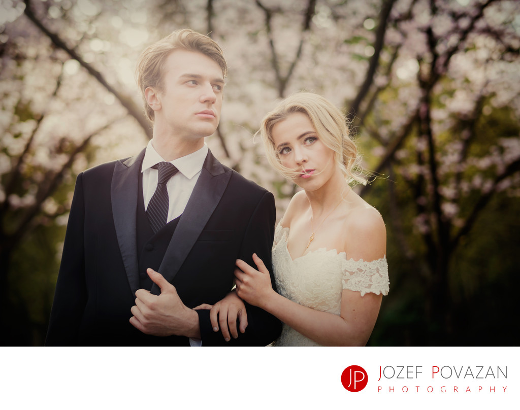Cherry blossoms wedding bride and groom portraits