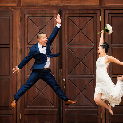 Roundhouse wedding photographer Jumping Bride and Groom