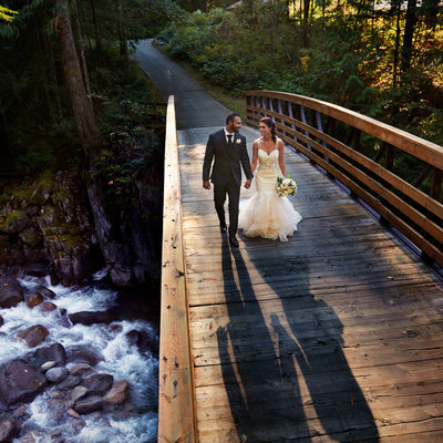 Furry Creek Wedding Bride and Groom at waterfall bridge