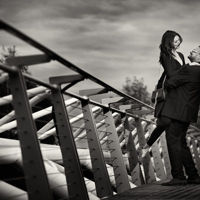 Olympic Village Engagement Photographer dance on bridge