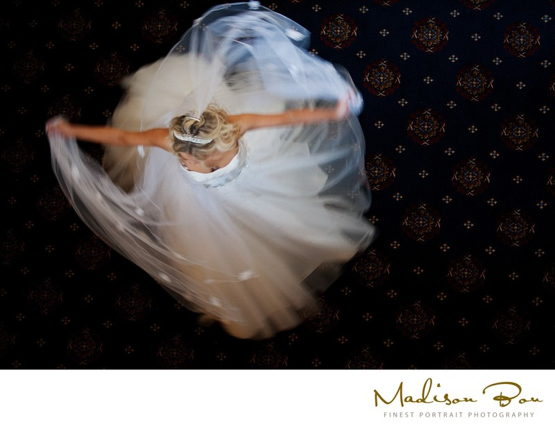 Bride spinning her wedding dress