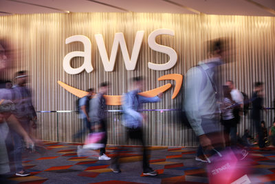 Blurred crowd rushing past AWS smile logo
