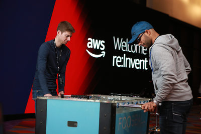 Foosball players in front of AWS branding
