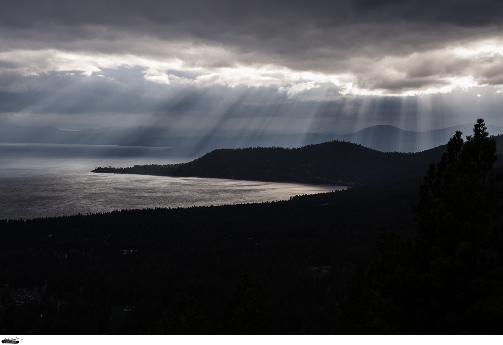 Lake Tahoe under thick clouds with sunrays