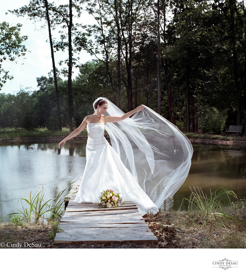 Bride on Dock with Long Veil in Solebury