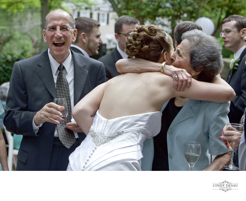 Fun Candid Photo of Hugs and Laughs During Receiving Line