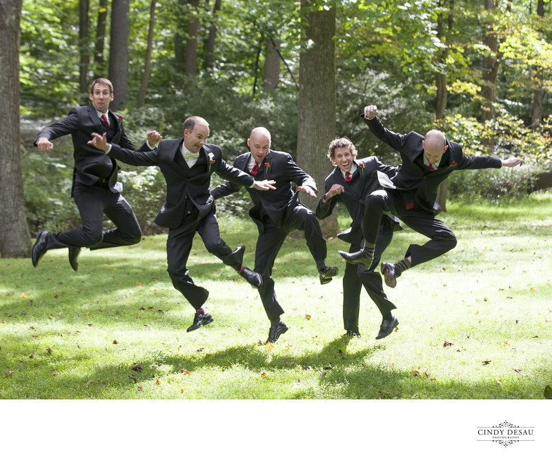 Leaping Groomsmen Having Fun Wedding Photo