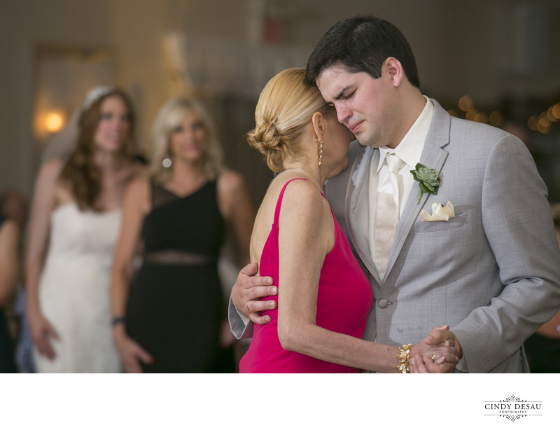 Emotional Groom and Mom Treasured Wedding Photograph
