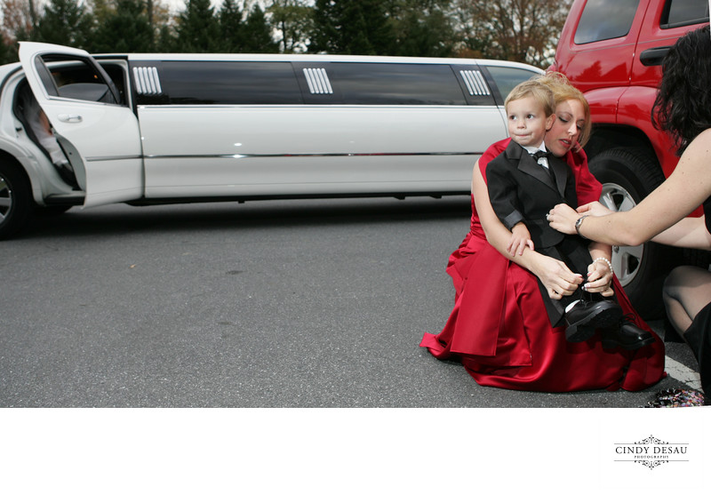 Ring Bearer Loses Shoes During Wedding Photographs