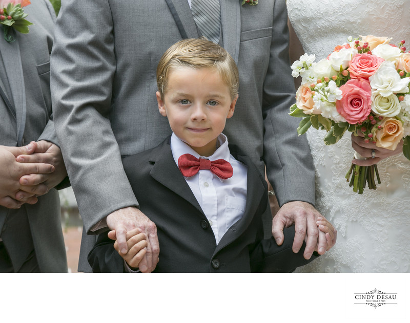 Cute Ring Bearer by Candid Wedding Photographer