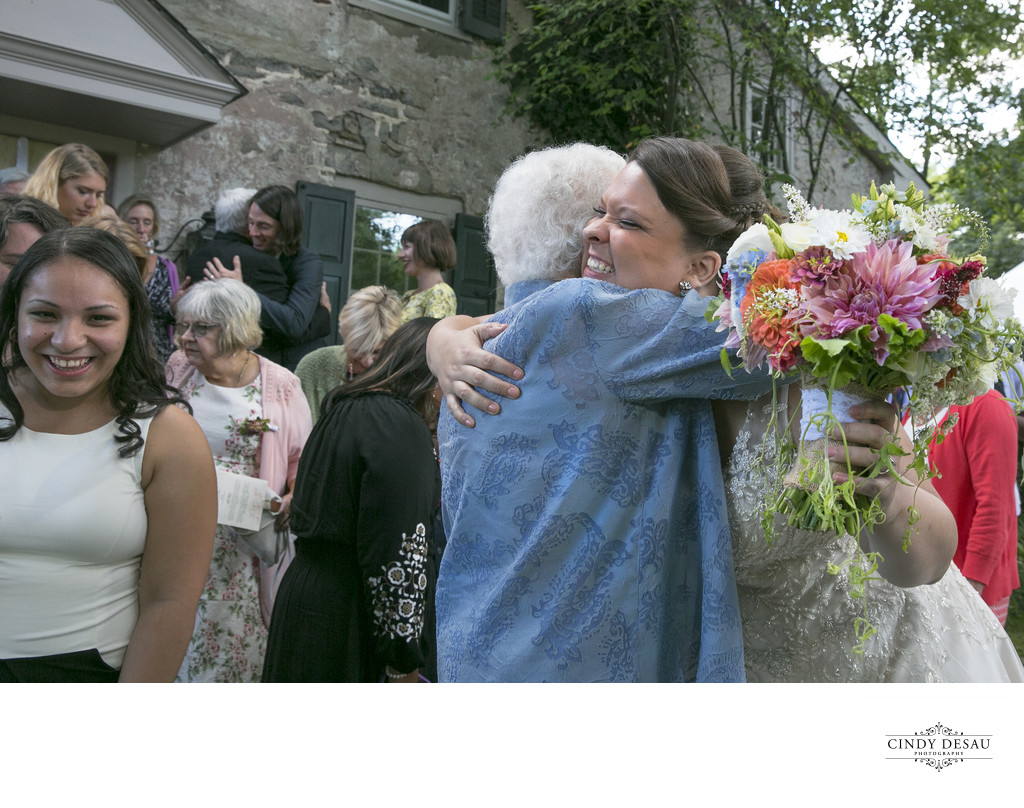Elated Bride Hugs Grandmother at Same Sex Wedding in New Hope