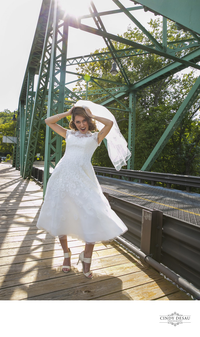 Playful Bride in the Wind on Centre Bridge Wedding Photo