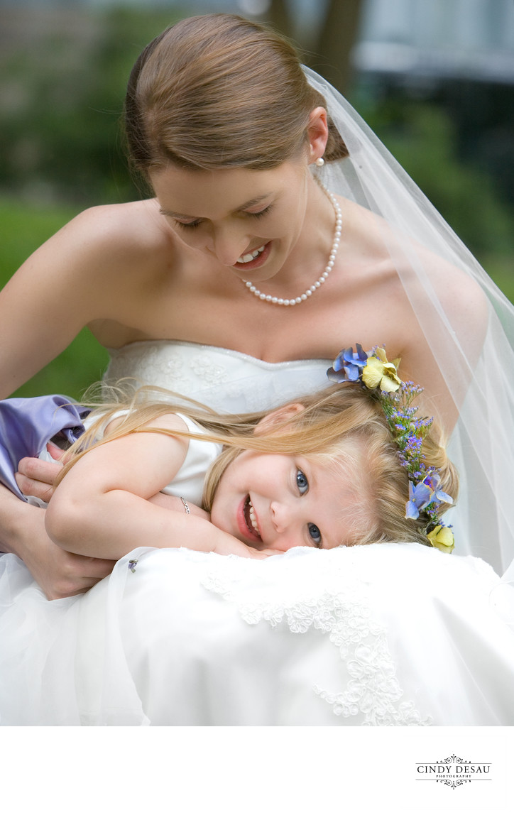 Adorable Flower Girl with Bride Moment
