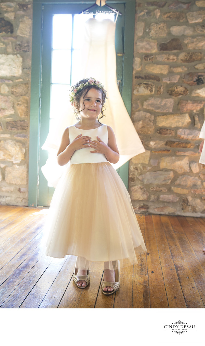 Happy Flower Girl Wears the Bride's Shoes