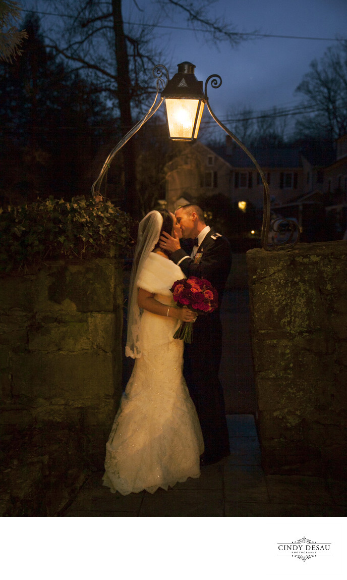 Holly Hedge Wedding Kiss in the Warm Glow of Dusk Photo