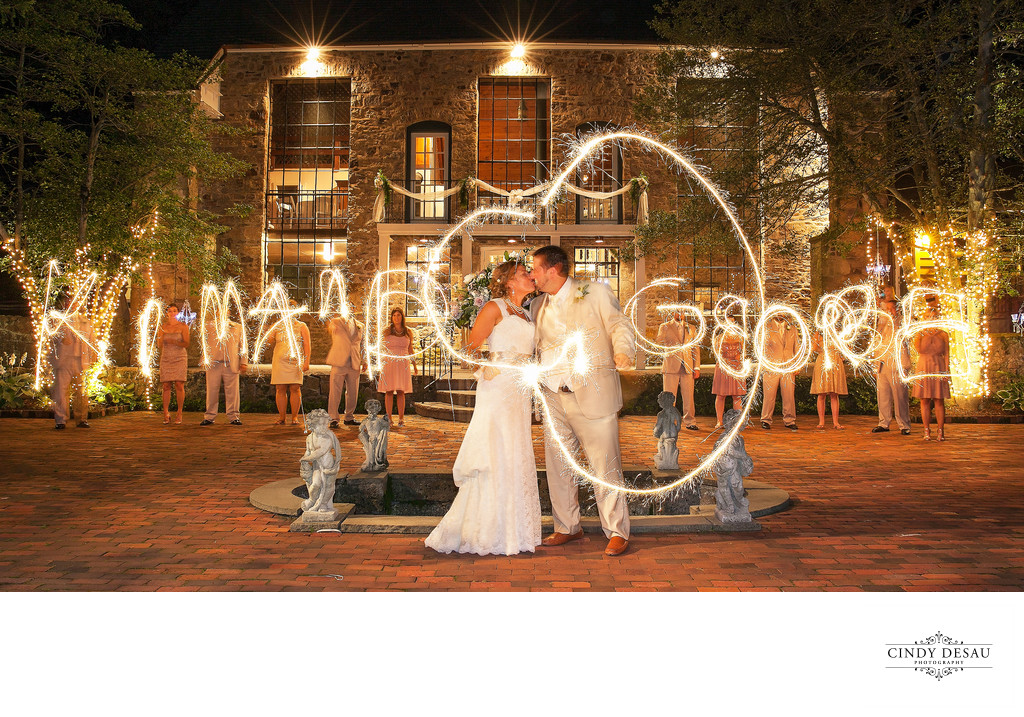 Bridal Party Spells Names of Bride and Groom with Sparklers in Bucks County