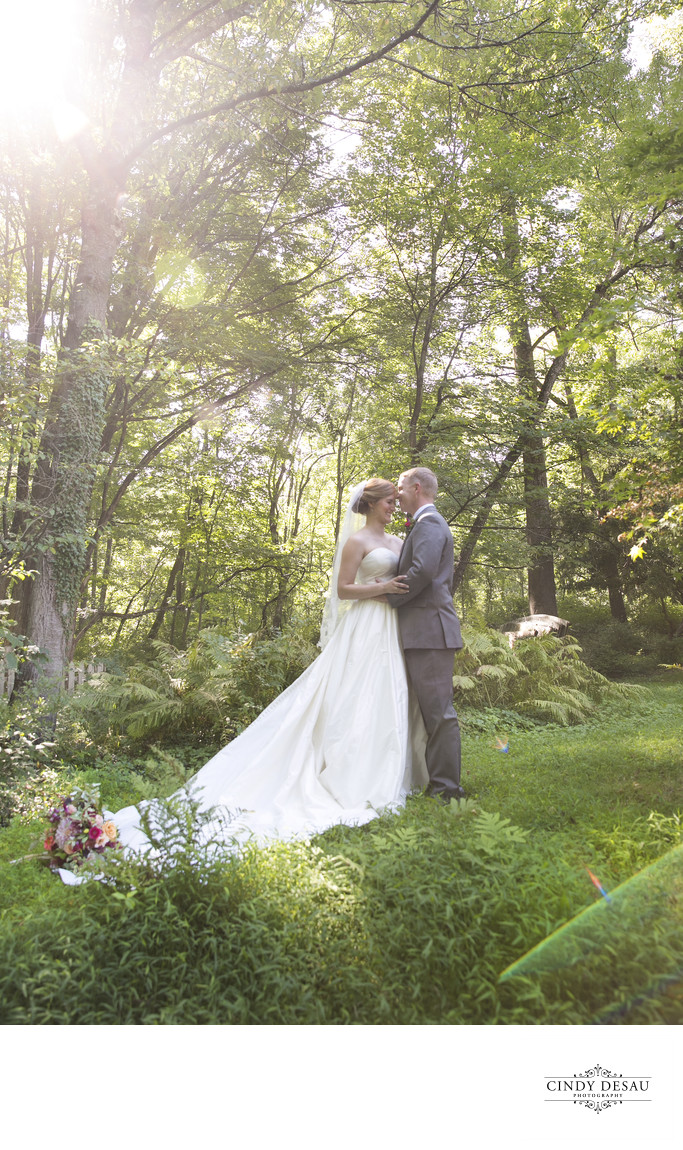 Bride and Groom Surrounded by Nature Photo