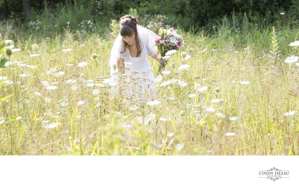 Boho Bride Picks Wildflowers on Her Wedding Day Photo