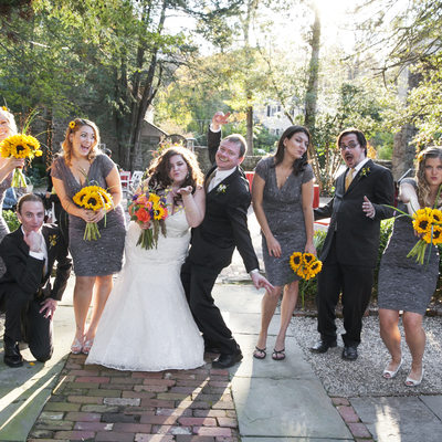 Fun Bridal Party Pose in New Hope with Sunflowers