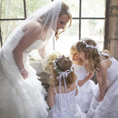 Bride Shares Bouquet with Flower Girls