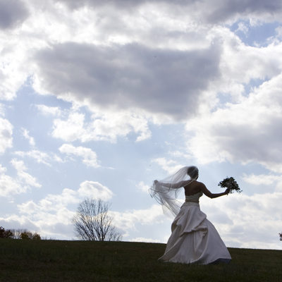 Pictorial Photographer of Bride Walking Up Mountain