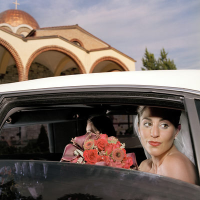 Bride in Limo Outside Greek Orthodox Church