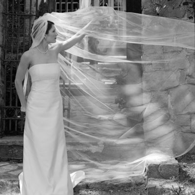 Playful Bride and Veil with Antique Gates at Holly Hedge