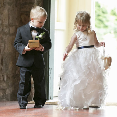 Timeless Moment of Ring Bearer and Flower Girl Processional Photo