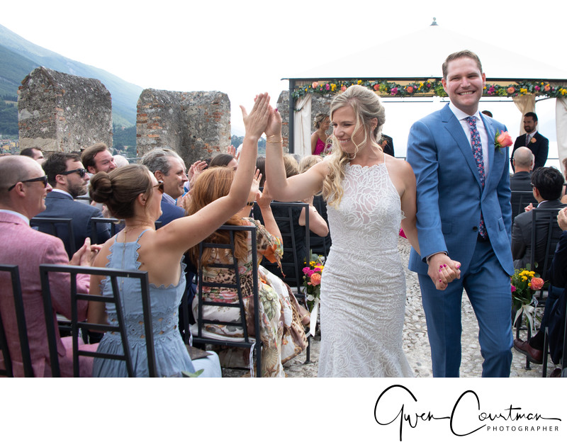 Hi 5 down the aisle, wedding in Italy.
