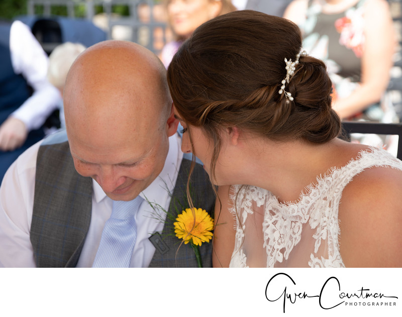 Intimate moment during the wedding in Malcesine Castle.