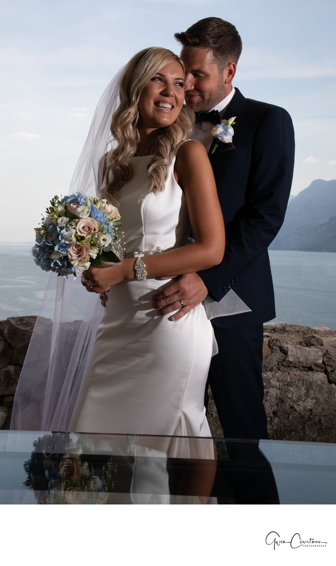 Happy bride and groom, Malcesine Castle Terrace, Italy