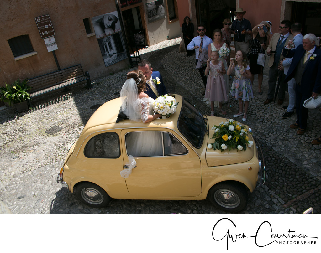Bride and Groom in Fiat 500, Malcesine Castle, Italy