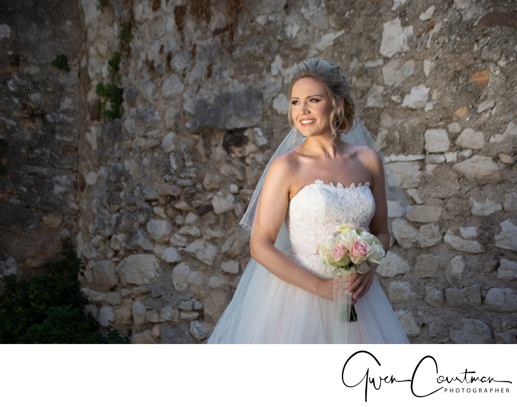 Beautifully lit Bride in Malcesine Castle