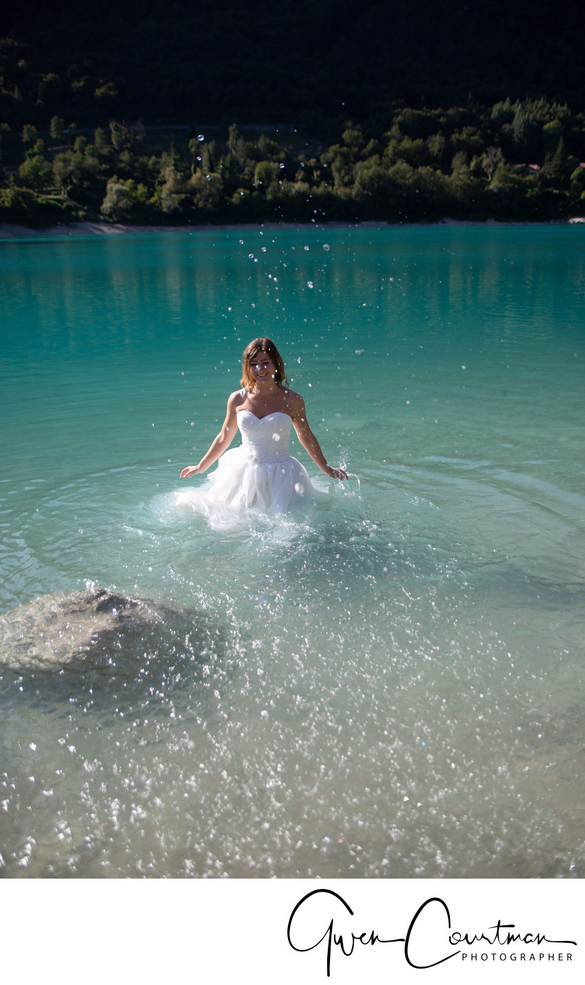 Bride splashing in Lake Tenno, Italy