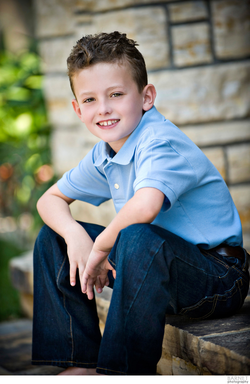 Environmental young boy's portrait on location