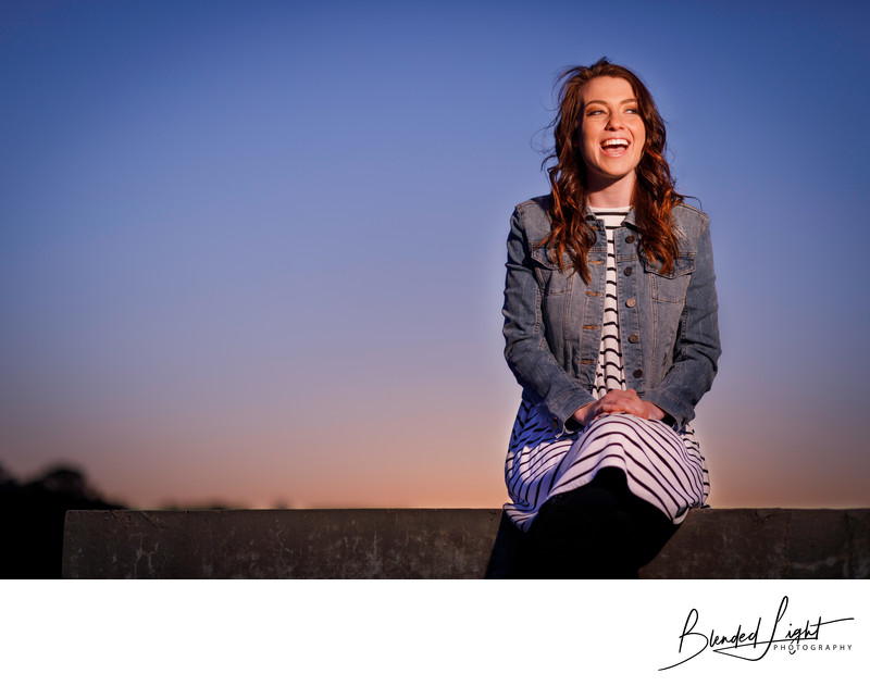 NC State senior enjoying a laugh in our senior session