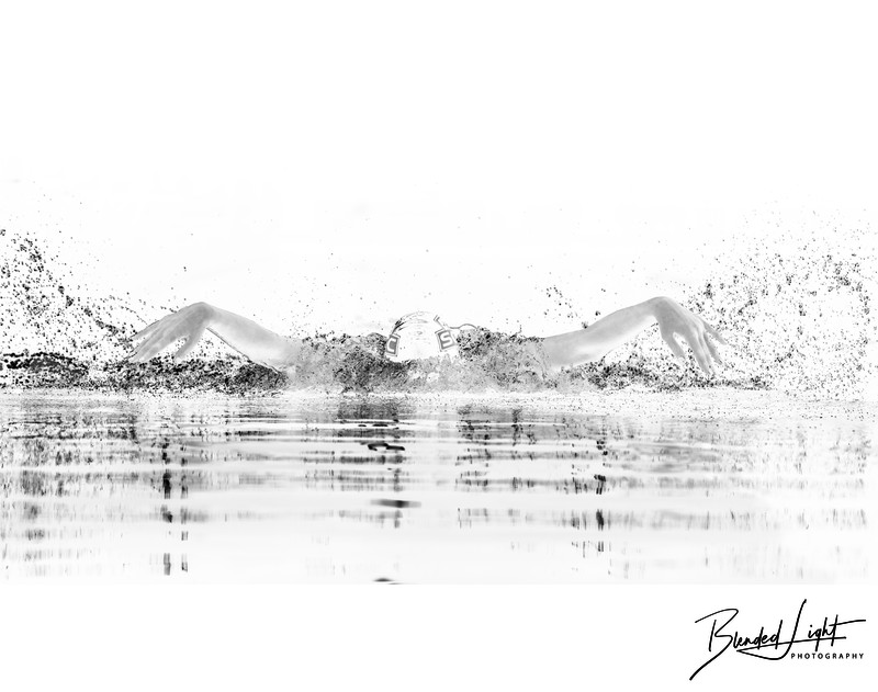 Black & white image of butterfly swim for young swimmer
