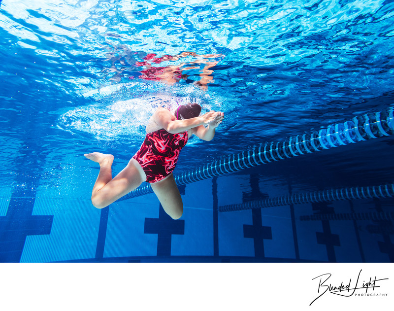 Competition pool image of teen breaststroke swimmer