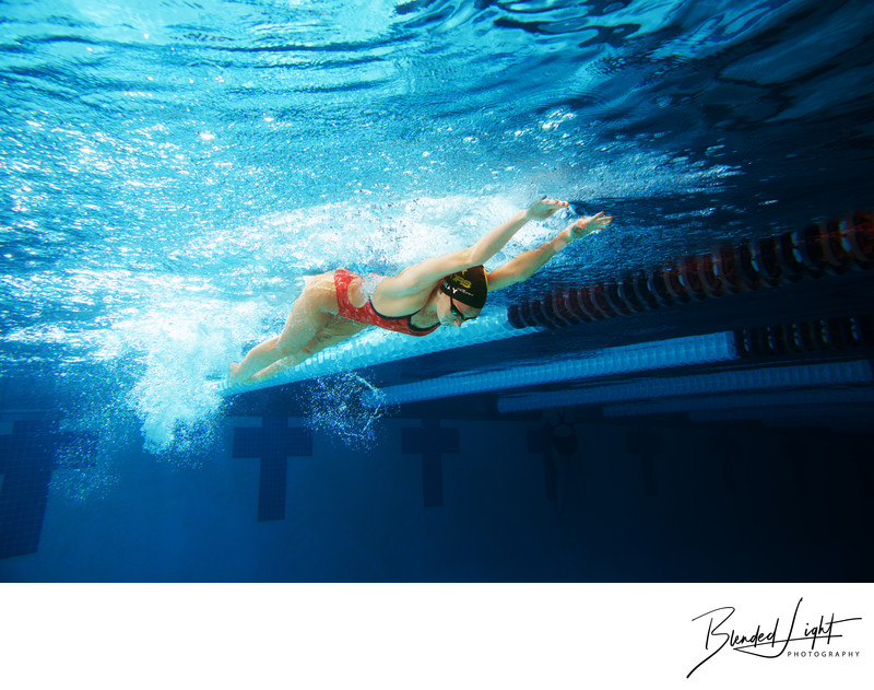 High School Senior swimmer image of butterfly stroke