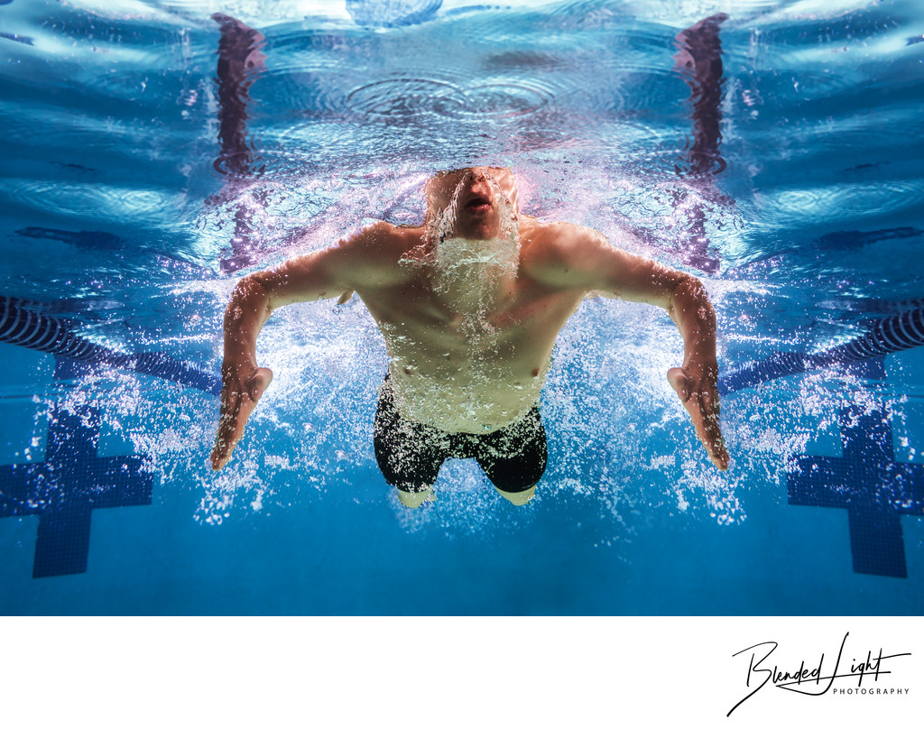 Breaststroke swimmer in perfect symmetry underwater pic