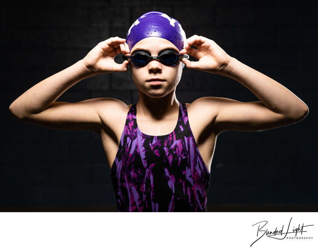 Awesome deck shot of young intense swimmer